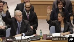 British Ambassador to the United Nations Mark Lyall Grant and American Ambassador Susan Rice vote during a Security Council vote on the peace and security in Africa, Saturday, Feb. 26, 2011 at U. N. headquarters.