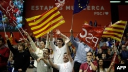 Socialist supporters wave flags during a campaign rally in Barcelona on Apr, 25, 2019 ahead of the Apr. 28 general election.