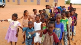 FILE - Children get ready to enter a class room in Yakouta, Burkina Faso.