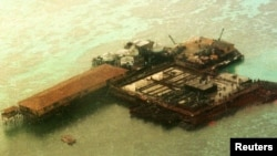 FILE - An aerial view of one of the structures built by China at the Philippine-claimed Mischief Reef, Spratly Islands in South China Sea.
