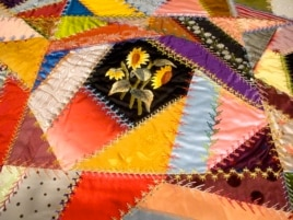 "Quilts assembled from small, irregular pieces of fabric are called ""Crazy"" quilts. This one, by Mary Stinson, was created around 1880. (J. Taboh/VOA)"