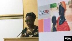 VOA Zimbabwe Service Chief, Ndimyake Mwakalyelye moderating the USAID program, Dec. 9, 2015.