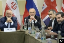 Iranian Foreign Minister Javad Zarif, left, Head of Iranian Atomic Energy Organization Ali Akbar Salehi, second left, Special Assistant to Iranian president Hossein Fereydoun, second right, and Iranian Deputy Foreign Minister Abbas Araghchi wait for the s
