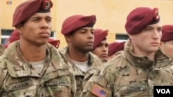 In this image taken from video, American military trainers are seen at the launch of joint U.S.-Ukrainian exercises in Yavoriv, Lviv region, western Ukraine, April 20, 2015.