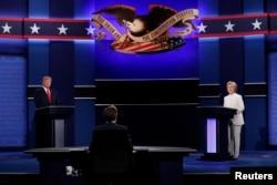 Republican U.S. presidential nominee Donald Trump and Democratic nominee Hillary Clinton begin their third and final 2016 presidential campaign debate at UNLV in Las Vegas, Nevada, U.S., October 19, 2016.