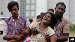 Родичі загиблих жертв вибуху біля моргу в Коломбо, Шрі-Ланка, неділя, 21 квітня 2019 року