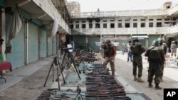 FILE - Pakistani soldiers display weapons reportedly captured from militants in Miran Shah in North Waziristan, July 9, 2014.