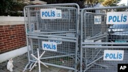 FILE - Security barriers block the road leading to Saudi Arabia's consulate in Istanbul, Turkey, Oct. 28, 2018.