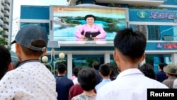 FILE - North Koreans watch a news report showing North Korea's nuclear test in Pyongyang, North Korea, Sept. 3, 2017. (Kyodo/via Reuters)