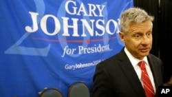 FILE - Libertarian presidential candidate Gary Johnson speaks to supporters and delegates at the National Libertarian Party Convention, in Orlando, Fla.