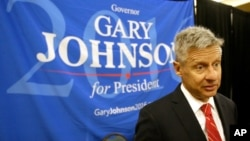 FILE - Libertarian presidential candidate Gary Johnson speaks to supporters at the National Libertarian Party Convention, in Orlando, Florida, May 27, 2016. He and Green Party candidate Jill Stein did not qualify to participate in the Sept. 26 presidential debate.