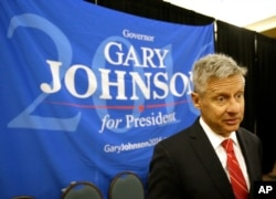 FILE - Libertarian presidential candidate Gary Johnson speaks to supporters and delegates at the National Libertarian Party Convention in Orlando, Fla., May 27, 2016.