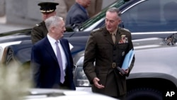 Defense Secretary Jim Mattis, left, and Joint Chiefs Chairman Gen. Joseph Dunford talk as they walk away from a briefing of U.S. lawmakers on the situation on the Korean Peninsula, at the Eisenhower Executive Office Building at the White House complex in Washington, April 26, 2017.