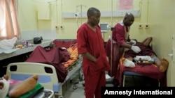 Paramedics treat a victim of Monday's explosion at Asokoro hospital in Abuja, Nigeria, April 15, 2014.