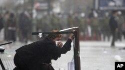 图为智利8月24日举行抗议时