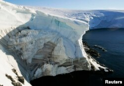 FILE - A record-size hole in the ozone layer has appeared over Antarctica. Shown here is a cliff face at Landsend, on the coast of Cape Denison.