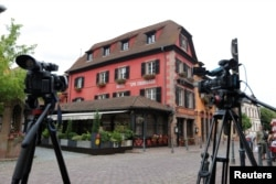 Media cameras are seen outside Le Chambard Hotel in Kaysersberg-Vignoble, where Bourdain was found dead on France, June 8, 2018.