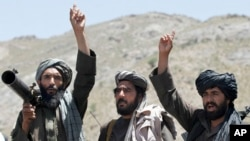 FILE - Taliban fighters react to a speech by their leader in the Shindand district of Herat province, Afghanistan, May 27, 2016. While Afghan officials and the U.S. military welcome Russian peace efforts, they are critical of Moscow's contacts with the Taliban.