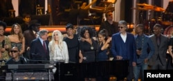 "Recording artist Stevie Wonder performs a medley, accompanied by performers India.Arie, Aisha Morris, Tony Bennett, Lady Gaga, Jennifer Hudson, Jill Scott, Ariana Grande, Andrea Bocelli, Pharrell Williams and Jamie Foxx (L-R), during the taping of the ""Stevie Wonder: Songs In The Key Of Life - An All-Star GRAMMY Salute"" concert at the Nokia Theatre in Los Angeles, Ca., Feb. 10, 2015."
