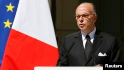 "FILE - French Interior Minister Bernard Cazeneuve, shown at a Paris news conference in August, notes that ""there are also Muslims and other minorities who are persecuted with the same degree of barbarity"" as Christians."