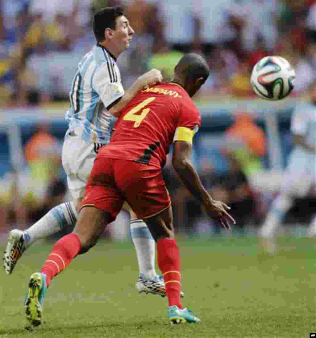 Argentina's Lionel Messi is fouled by Belgium's Vincent Kompany during the World Cup quarterfinal soccer match between Argentina and Belgium at the Estadio Nacional in Brasilia, Brazil, Saturday, July 5, 2014. (AP Photo/Eraldo Peres)
