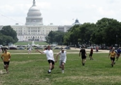 Shana Wallace, far right, in yellow, playing with DC Pickup teammates in an ultimate Frisbee game on the National Mall.