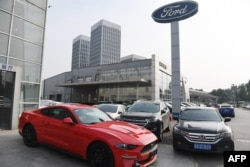 A Ford Mustang is seen at a dealership in Beijing on July 6, 2018.
