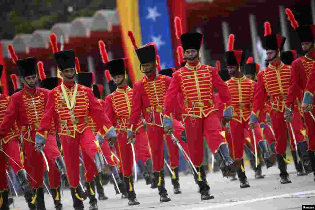 Venezuelan soldiers take part in a military parade in Caracas, Feb. 1, 2017.