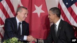 President Barack Obama, right, shakes hands during a bilateral meeting with Prime Minister of Turkey Recep Tayyip Erdogan. (file)