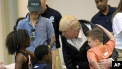 President Donald Trump and Melania Trump meet people affected by Hurricane Harvey during a visit to the NRG Center in Houston, Texas, Sept. 2, 2017.