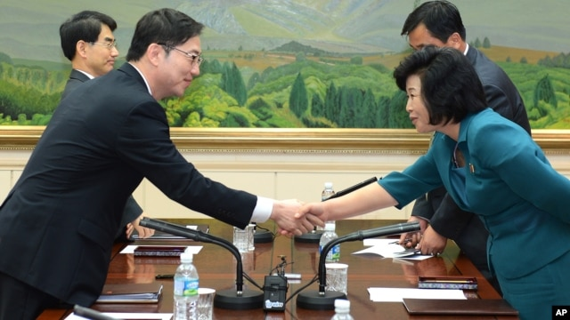 In this photo released by the South Korean Unification Ministry, South Korea's Unification Policy Officer Chun Hae-sung, left, shakes hands with the head of North Korea's delegation Kim Song Hye, right, June 10, 2013.
