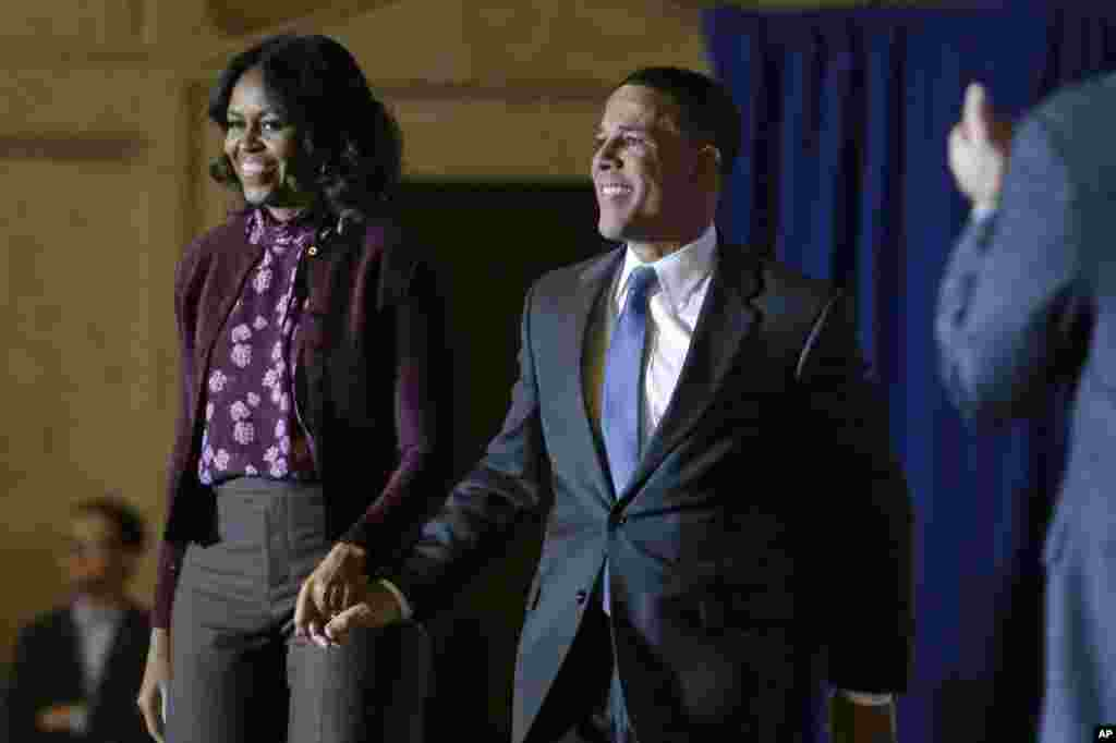 First lady Michelle Obama and Maryland Democratic gubernatorial candidate, Lt. Gov. Anthony Brown, walk together on stage during a Get Out the Vote rally, Baltimore, Maryland, Nov. 3, 2014.