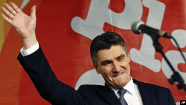 Croatian opposition party leader Zoran Milanovic celebrates the parliamentary election after exit polls showed his party won a majority in parliament, in Zagreb, Croatia, December 4, 2011.