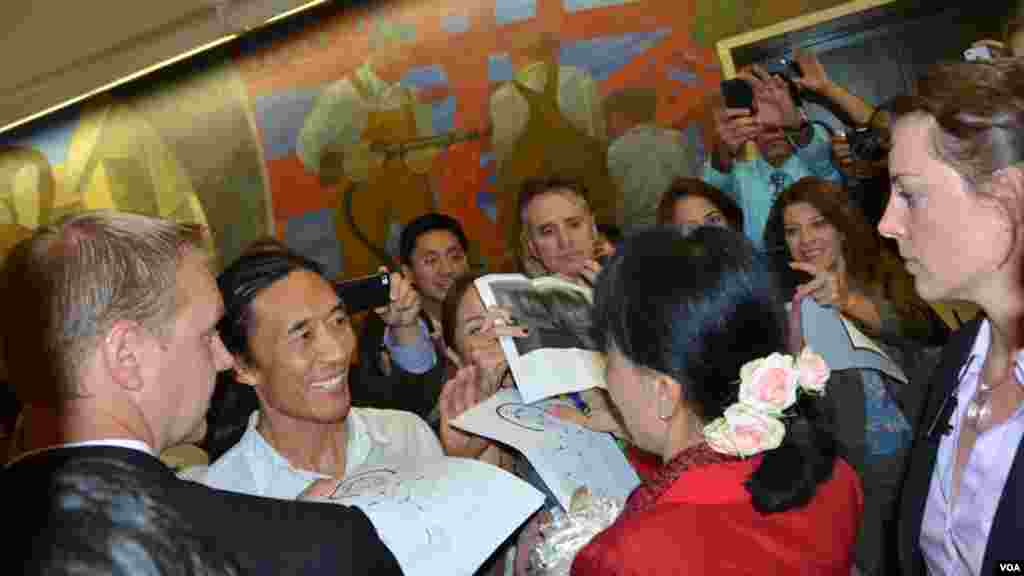 Aung San Suu Kyi granted VOA several interviews over the years, and her fans at the headquarters gather around to get an autograph and picture.