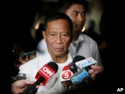 FILE - Philippine Vice President and an opposition presidential candidate Jejomar Binay talks to the media following his forum with the business sector, Oct. 7, 2015 at the financial district of Makati city, east of Manila.