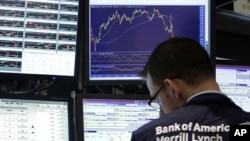 A specialist works at his post on the floor of the New York Stock Exchange, Tuesday, Aug. 9, 2011