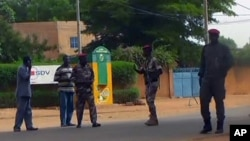 Army soldiers patrol outside the prison after unidentified gunmen attacked the central prison in capital city Niamey, Niger, June 1 2013.