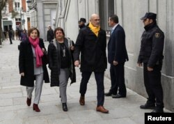 Catalan politicians (L-R) Carme Forcadell, Dolors Bassa and Raul Romeva arrive together to the Supreme Court after being summoned and facing investigation for their part in Catalonia's bid for independence in Madrid, Spain, March 23, 2018.