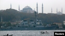 U.S. Navy guided-missile destroyer USS Ross, with the Byzantine-era monument of Hagia Sophia in the background, prepares to leave from the port in Istanbul, Nov. 13, 2014.