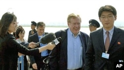 Ambassador Robert King (C), U.S. envoy for North Korean human rights, and his party arrive at Pyongyang airport in North Korea, May 24, 2011
