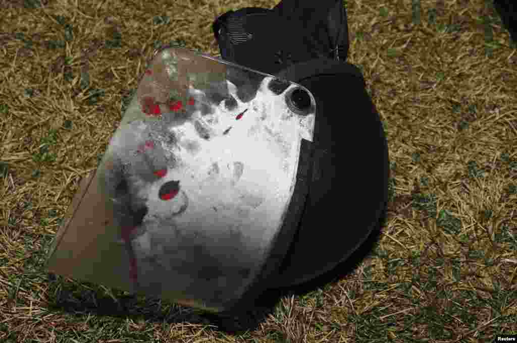Police photo collected at the scene from the St. Louis County Police Crime Scene Unit shows a police helmet where two police officers were shot just after midnight in Ferguson, Mo.