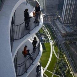 People enjoying the unusually shaped balconies of Aqua
