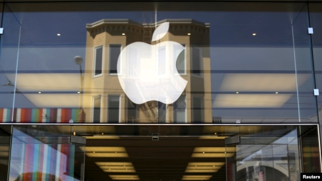 The Apple logo is pictured on the front of a retail store in the Marina neighborhood in San Francisco, California, Apr. 23, 2014.