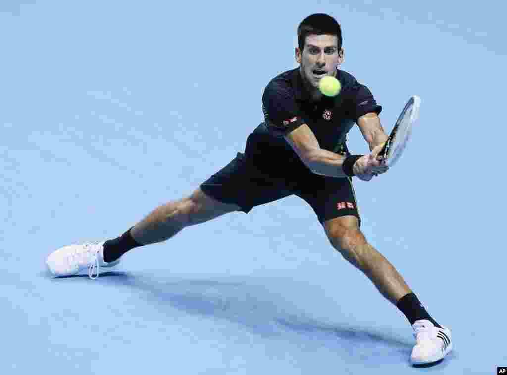 Još dokaza da je Đoković ne samo najbolji već i najfleksibilniji teniser sveta (AP Photo/Kirsty Wigglesworth)