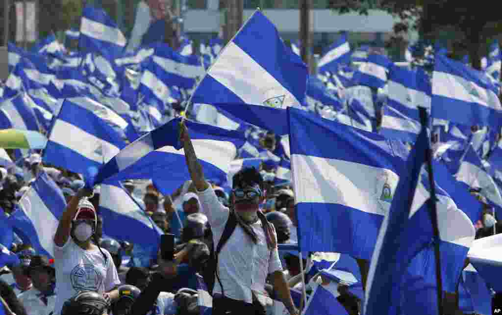 Demonstrators protesting government repression wave Nicaraguan flags in Managua, May 9, 2018.