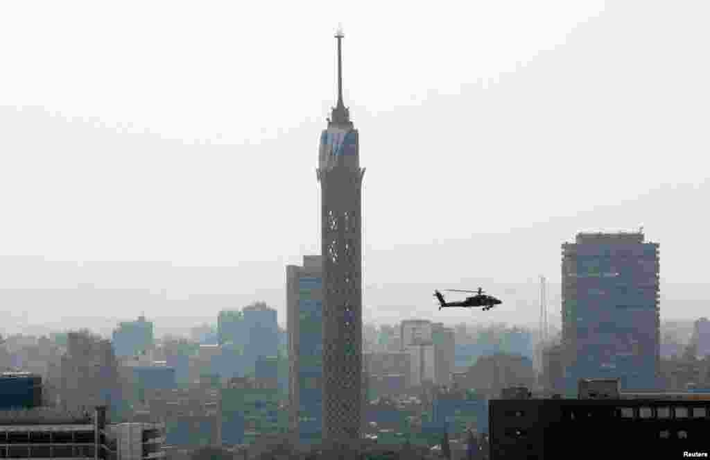An Egyptian military helicopter near the Cairo tower, Friday, July 26, 2013.