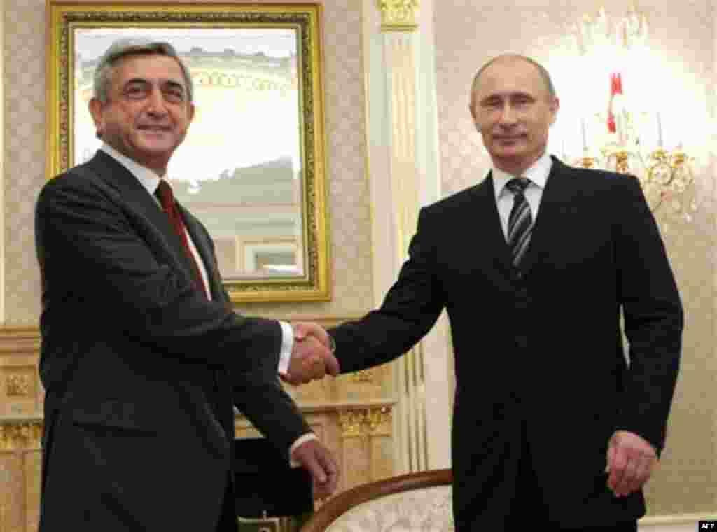 Russian Prime Minister Vladimir Putin, right, shakes hands with Armenian President Serge Sarkisian during their meeting in Moscow, Russia, Wednesday, Nov. 17, 2010.(AP Photo/RIA Novosti, Alexei Nikolsky, Pool)