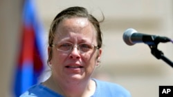 FILE - Rowan County Kentucky clerk Kim Davis speaks to a gathering of supporters during a rally on the steps of the Kentucky State Capitol in Frankfort Ky., Aug. 22, 2015.
