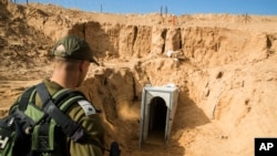 An Israeli soldier stands on the Israeli side of the border with Gaza, near the opening of a tunnel, that Israel says was dug by the Islamic Jihad militant group, leading from Gaza into Israel, near the southern Israeli kibbutz of Kissufim, Israel, Jan. 18, 2018.