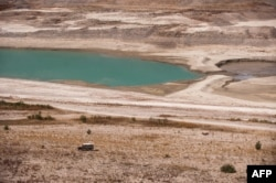 FILE - A partial view of Lar dam's reservoir at Damavand, 70 kilometers northeast of Tehran. Authorities warned Tehran residents to drastically reduce their water consumption, as three of the five dams supplying the capital are almost empty, Sept. 17, 201